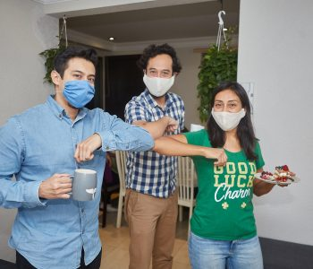 meeting of friends with face masks returning to new normal